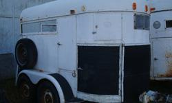 1970s horse trailer for sale. Easily fits a larger size QH or two smaller horses. Minor surface rust but good frame. Floorboards good. Brand new wiring and lighs last year. New tires. Trailer dimensions: Total length-approx 10feet incl hitch, Inside