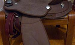"""Selling a light brown King series synthetic western saddle, full quarter horse bars, 16"""" seat.  Used a couple times, stirrups are a bit dirty, etc, this is why it's only $200 - saddle is still in very good, near new condition. Cinch/pad not included but I"""