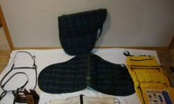 New english brast plate $35.00.  Two New lined English  Saddle Bags $40.00 each , one set of new western stirups with patting medium color $ 30.00. Yellow Tough-1heavy poly/nylon grooming carrier bag still in plastic bag $25.00. A dark blue Phoenix