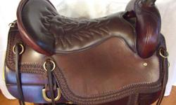 AWESOME CHEYENNE FRONTIER SADDLE IN BRAND NEW CONDITION.16.5 western sizing 17.5 Tucker with a MEDIUM tree,SEMI 1/4 horse bars.Weight 25lbs, 5 inch cantel for awesome security in the seat! Brown with brass hardware.Leather laced stirrups,Famous Gel-Cush