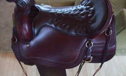 """AWESOME TUCKER CHEYENNE FRONTIER TRAIL SADDLE IN NEW CONDITION.Tooled, brown 16 inch western sizing/17"""" Tucker sizing(160-250lbs) gel-cush shock absorbing seat, Semi 1/4 horse tree(Med.) Only used a handful of times! Call for more info at"""