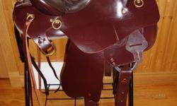 """BRAND NEW!!!  15 1/2"""" Tucker Endurance Saddle   What a beauty of a saddle!   You can ride in this saddle all day long because of its Gel-Cush Shock Absorbing seat.  Comfort is in the stirrups too.  There's no horn to poke you when you duck under low"""