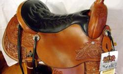 2011 NEW MODEL MEADOW CREEK ,TOOLED,LIGHT OIL 16.5 TUCKER SIZING/15.5 WESTERN SIZING(126-185LBS)only a few rides on this beautiful saddle! Has full 1/4 horse bars(Wide), optional JEREMIAH WATT Horseshoe brand conchos ,comfy gel-cush seat that Tuckers are