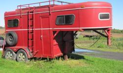 "Two horse trailer, 6'9"" tall inside, rear loading ramp.   Asking 2200 obo"