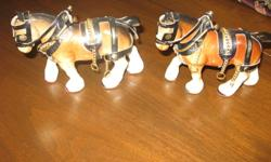 "A PAIR OF PORCELAIN DRAFT HORSES IN FULL HARNESS.  THESE HAVE BEEN AROUND FOR A LONG TIME, 60'S MAYBE AND HAVE BEEN PACKED AWAY.  EXCELLENT CONDITION.  FELT ON BOTTOMS OF FEET.  MEASURE APPROX.  5.5"" FROM NOSE TO BACK FOOT AND 4"" HIGH.  IF YOU HAVE A"
