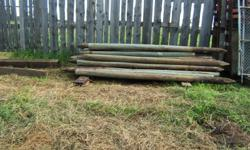 """We have a selection of 12'x 8"""" (approximately 45), and 5' (approximately 30) wooden posts. They are used but with no rot on either size, and both sizes have been treated. Call for details on pricing."""