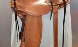 Custom made Wade Saddle for sale.  Rod Great price on a hand made saddle.  Nikkel tree, sheepskin lined skirts, Bork brass hardware, 15 3/4 inch seat, Hermann Oak skirting, all the best of quality materials.  4 x 90 degree bars to fit most horses, and