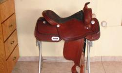 "Western saddle, Griffith 9607, 16"" seat, only used twice.  Purchased from Pleasant Ridge Saddlery in Brantford for $599.00 on sale."