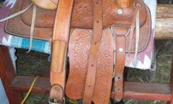 """Beautiful Pony Saddle in Excellent Condition. Comes with rear cinch. 12"""" seat   Saddle Blanket, also in Excellent Condition.   (used only a few times)   Studded Pony Bridle.     Email or call Janice at 767-7955"""