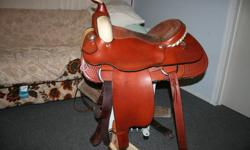 "Western Rawhide 16"" seat.  It is called the  ""Welland Roper Style #1646.  Ralide quarterhorse bar tree with a 16"" seat.  6 3/4 wide by 7 3/4 high gullet.  12"" front and 4 1/2 cantle.  Western Rawhide is a Canadian Saddle Co. that has been in business for"