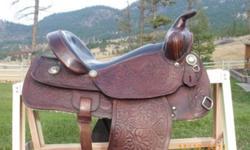 Western pleasure/trail saddle with padded seat, latigo and back cinch. Good shape.