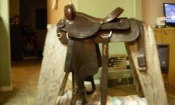Quality 15 1/2  western saddle, very good condition. Made by Ron's leatherwork Sue 250 379 2079
