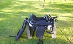 17'' western saddle black with silver trim also saddle pad bridle reins and breast strap all are new.