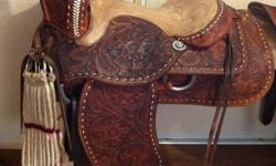 """15"""" western saddle. Older but in good condition. Clean, light weight saddle. Has beautiful tooling with Buckstitching, Big stirrups, good fleece, solid horn & tree. Very comfortable. Asking $350 firm. This ad was posted with the Kijiji Classifieds app."""