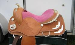 "Pink seat western saddle, 16"",  Price $500 Includes bridle & breastplate.  Ridden in six times.  Used on quarter horses."