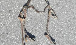 All of the following is FULL sized: Leather western pleasure bridle Snaffle bit with chin strap (looks rusty, just dirty) Set of leather pleasure split reins Black nylon tie-down with red/white/blue pattern Black nylon padded breast collar with