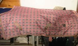 """2- winter waterproof heavy turn out blankets. Both are made by century. Light pink and baby blue plaid size 63"""" baby blue and light pink size 68"""". Both are in excellent condition (pink one has a small tear) washed and ready to use. Asking $35 each or $60"""